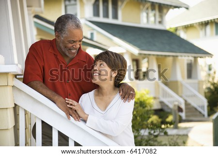 African American middle aged couple smiling at each other. - stock photo