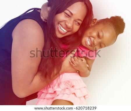 African American Mother Daughter Hug Together Studio Portrait