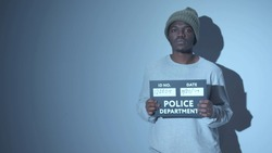 African American photographed. mugshot sign