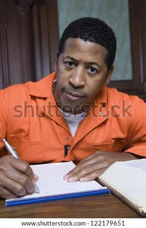 African American prisoner confessing crime on paper