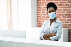 African American Reception Desk Woman Wearing Mask