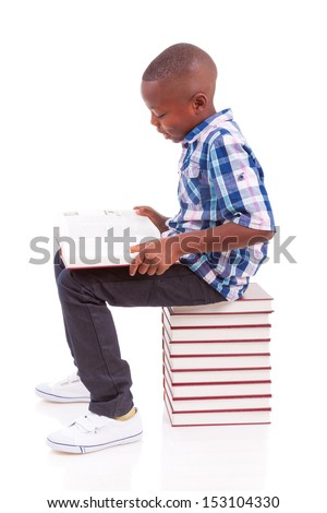 African American school boy reading a book, isolated on white background - Black people