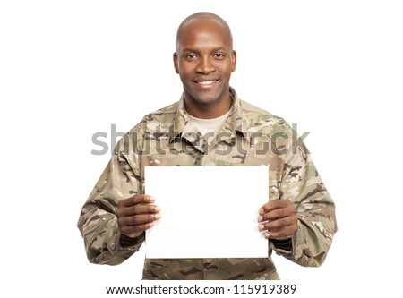 African American serviceman holds a sign