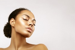 African American skincare models portrait. Beauty spa treatment concept.Young girl posing with closed eyes against grey background