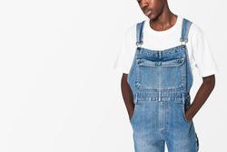 African American teen boy in denim dungarees streetwear apparel shoot