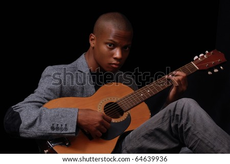 african-american teen playing the guitar