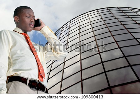 African American teenage man talking on the phone