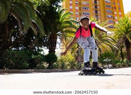 African American teenager skating towards the camera