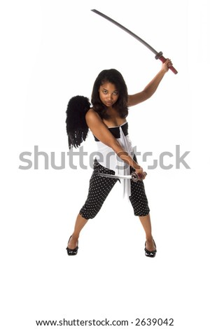 African American woman as a Ninja Angel with black feather wings and an intense expression attacks with a pair of Samurai Swords