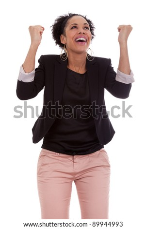 African american woman celebrating success with clenched fists on white background