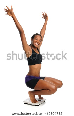 African American woman cheering on scale isolated over white background