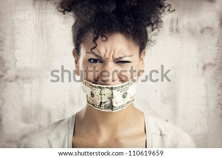 African American woman covering her mouth with a dolar banknote, great concept for the global crises