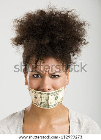 African American woman covering her mouth with a dollar banknote, great concept for the global crises