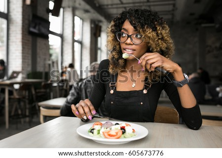 african american woman eating #605673776