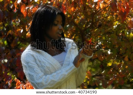 African-American woman emotionally aroused about the colors on the leaf