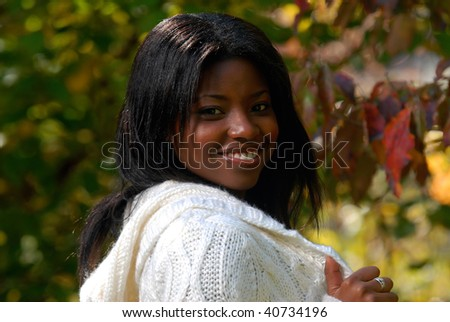 African-American woman enjoying a fall day outside