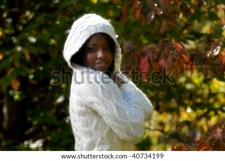 African-American woman feeling a cool fall day