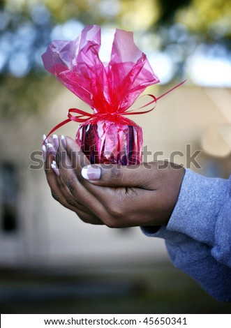 African-American woman: giving hands