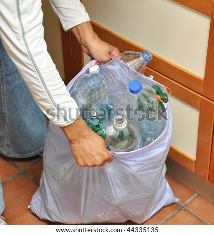 African American woman Hands grabbing recycling trash bag