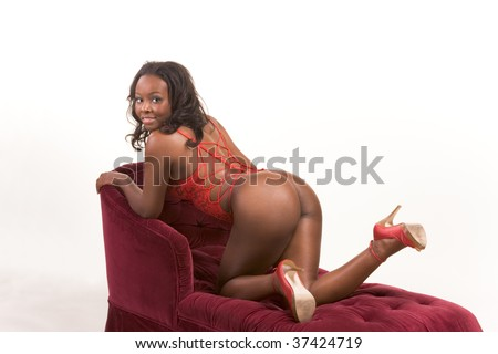 stock photo african american woman in red lingerie on couch in sensual erotic seductive pose demonstrating her 37424719 Hot nude beach girls party on a white yacht, photo 1