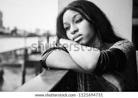 African American woman is sitting and contemplating something