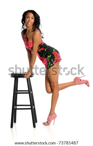 African American woman leaning on stool isolated over white background