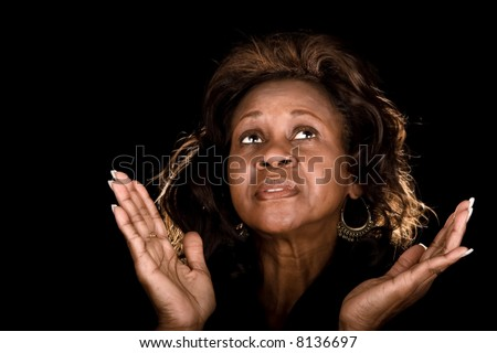 stock photo : african american woman praying with outstretched hands,