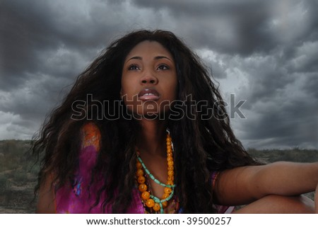 African American woman sits in the safari; staring, and thinking