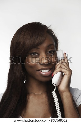 african american woman talking on the phone and she looks happy