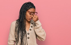 African american woman wearing casual clothes tired rubbing nose and eyes feeling fatigue and headache. stress and frustration concept.