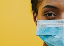African american woman wearing medical mask against corona virus