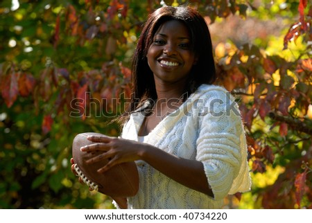 African-American woman with a football