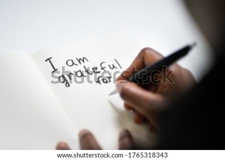 African American Women Writing In Gratitude Journal ストックフォト ©