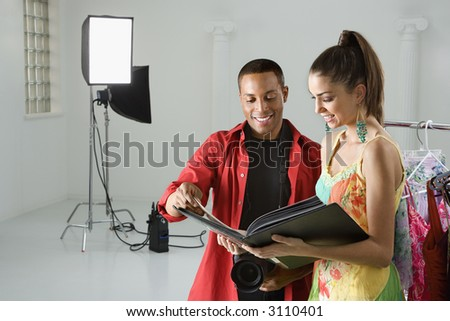 stock photo : African American young male adult photographer and young adult ...