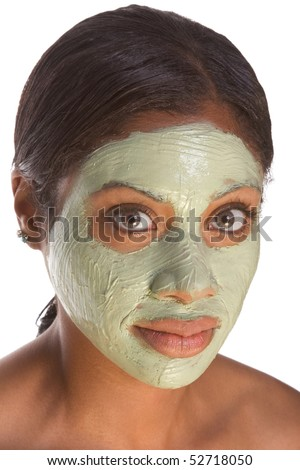 African-American young woman relaxed with facial mask, undergoing skincare procedure