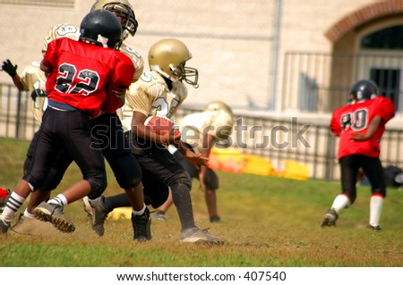 African American youth playing football