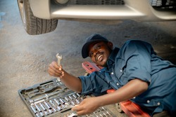 African Auto mechanics are choosing hand checking and fixing for repair car,service via insurance system at garage