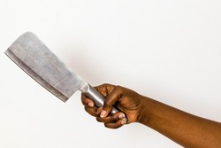 African Black American hand holds butcher knife or cleaver isolated on white