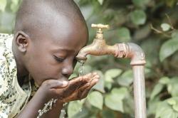 African Black Boy Drinking Fresh Clean Water