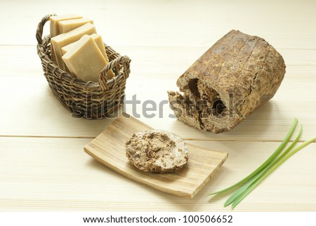 african black soap and homemade soaps on wooden