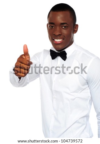African boy in party-wear gesturing thumbs-up isolated over white background