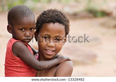 African brother and sister deprived children in a village near Kalahari Desert
