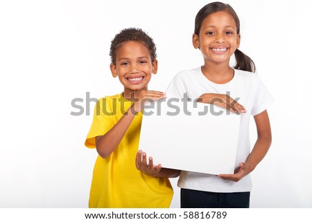 african brother and sister holding a white board