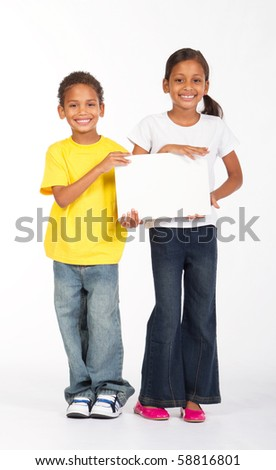 african brother and sister holding a white board - stock photo