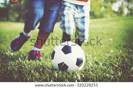 African Brother Playing Football Outdoors Concept