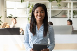 African business woman leader of department company representative portrait, successful office worker holds tablet smile look at camera ready to start meeting with client, skilled staff member concept