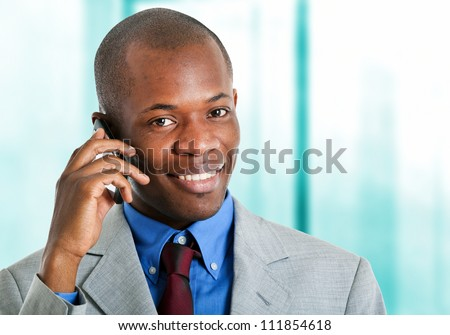 African businessman at phone in his office