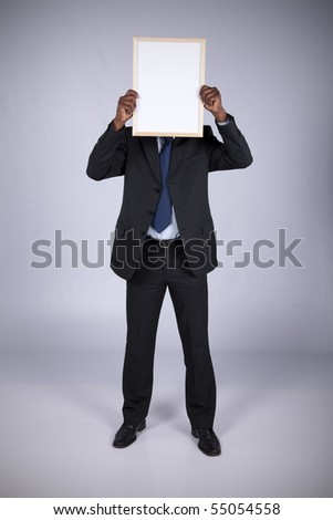 african businessman holding a blank whiteboard