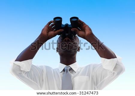 African Businessman looking through binoculars