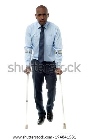 African businessman man walking with crutch